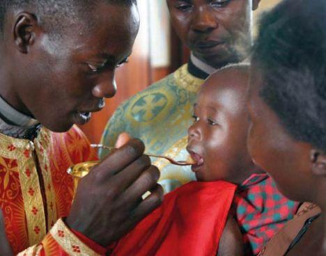 Africa-Orthodox-Church-child-receives-Holy-Communion-at-St.-Nicholas-Orthodox-Church[1]